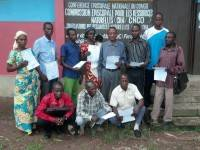 """Pierre, our school director (back row, 5th from left) and 10 teachers in front of """"Caritas"""" office in Tshikapa after receiving their first salaries"""